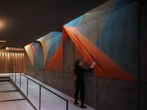 Playful Rope Installation Adds Multifaceted Color to Gray Concrete Space