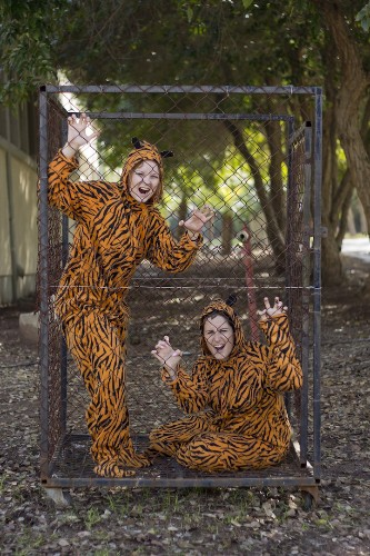 Photographer Persuades Strangers to Strike a Pose Wearing a Tiger Suit