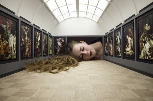 People Stick Their Heads into Miniature Galleries to Become Part of World Famous Art Exhibits