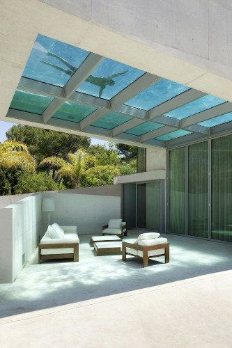 Stunning Spanish Home Built Around Transparent Rooftop Pool