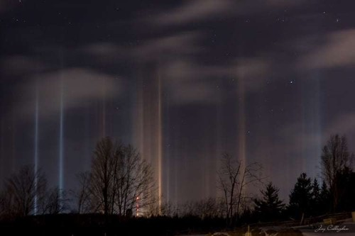 Streaking Light Pillars Illuminate the Night Sky