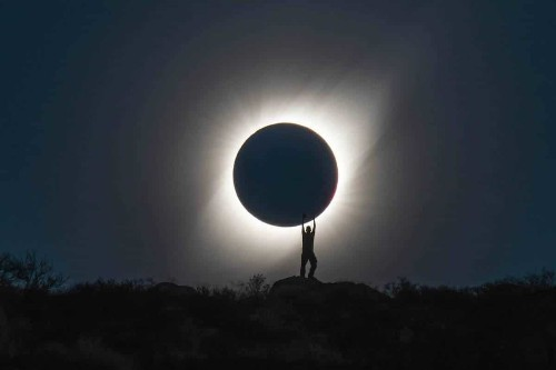 "Perfectly Timed Photo Captures a Person ""Holding"" a Total Solar Eclipse"