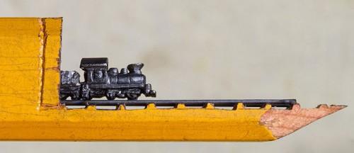 Artist Carves Pencil Lead into the Tiniest Train on Rails