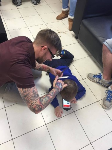 Barber Goes Above and Beyond to Make Boy with Autism Comfortable During Haircut
