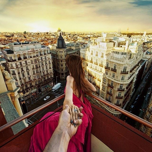 Photographer's Girlfriend Continues to Lead Him Around the World