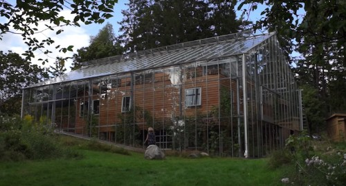Ingenious Couple Wrapped Their House in a Giant Greenhouse to Keep It Warm