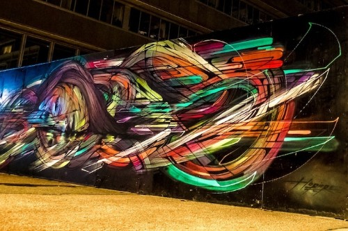 Street Artist Blasts Streaks of Color in Stunning Portrait