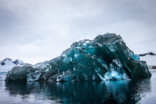 Vivid Photos of a Rare Flipped Iceberg in Antarctica