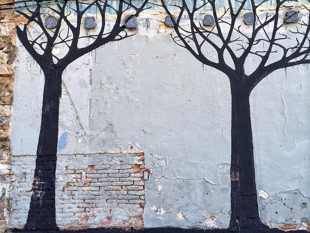 Surreal Silhouettes of Talking Trees in Barcelona