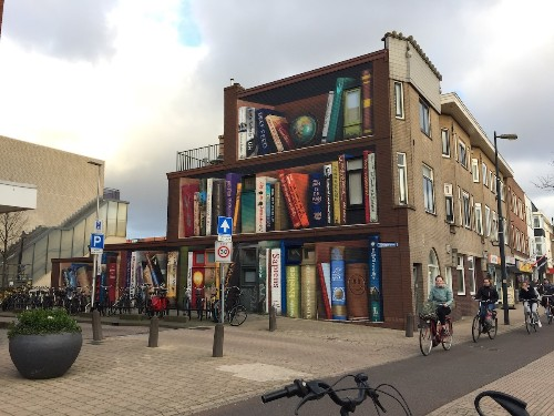 Street Artists Transform an Ordinary Building into a Spectacular Bookcase
