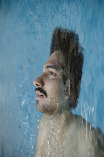 Half-Submerged Men Caught Between Dreams and Reality