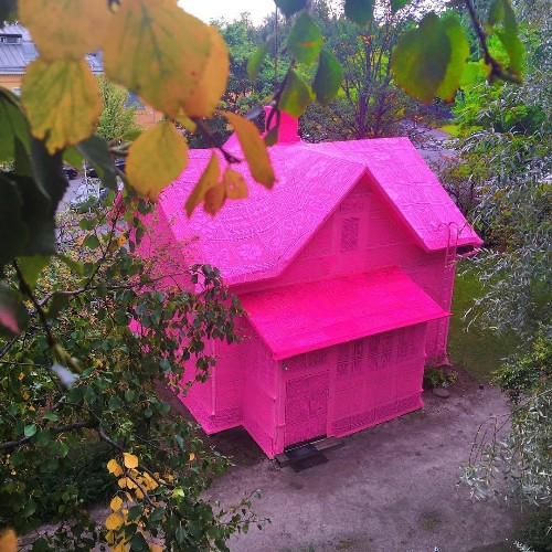 Master Yarn Artist and Team of Refugee Women Cover House in Pink Crochet as a Symbol of Hope