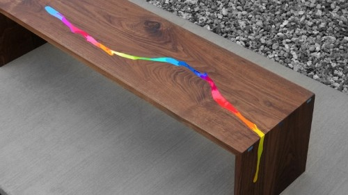 Wooden Table Has Rainbow River of Melted Crayons Flowing Through It