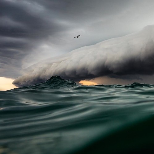 Photographer Swims Out to Sea to Capture Spectacular Storm Shot