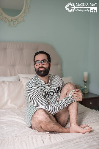 Husband Playfully Poses for the Man-Version of a Sexy Boudoir Photo Shoot