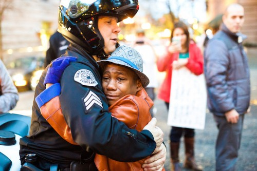 Powerful Story Behind the Young Protestor Hugging a Police Officer at a Ferguson Demonstration