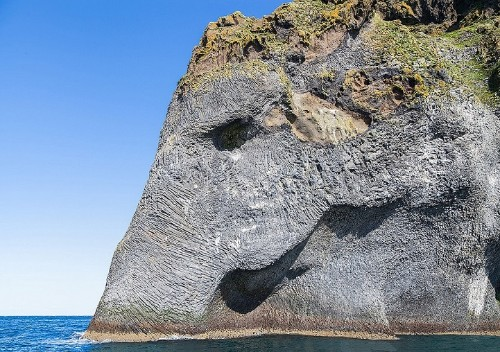 Natural Rock Formation Looks Like an Elephant Drinking from the Ocean