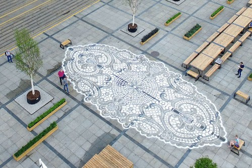 Street Artist Adds a Delicate Touch of Lace to Public Urban Spaces