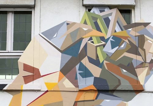 Artist Uses Discarded Doors to Create Giant Street Murals