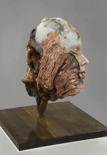 Artist Repurposes Found Driftwood Into Surreal Self-Portrait Sculptures