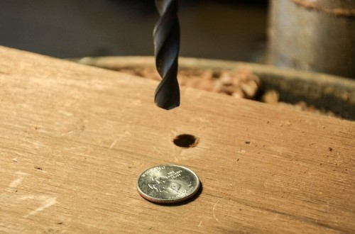 Designer Drills Holes into Quarters, Turns Them into Rings