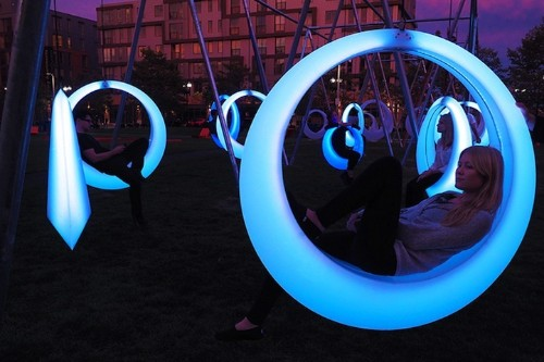 Glowing Interactive Circular Swings Change Colors with Motion