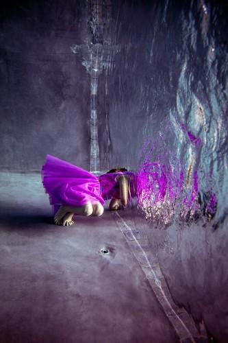 Vibrant Submerged Figures Greet Surreal Mirror-Like Liquid Portals