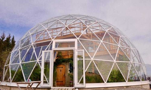 Cob House Surrounded by Geodesic Dome in the Arctic Circle