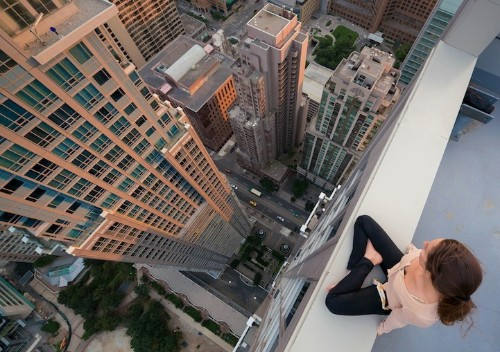 Exhilarating Shots of Thrill-Seekers Strolling Atop Skyscrapers