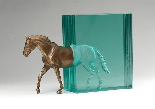 Bronze and Glass Horse Appears to Exit a Cascade of Water