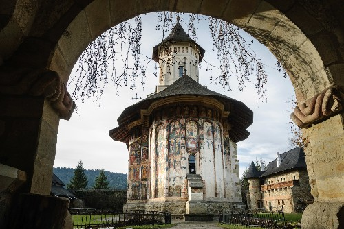 Vibrant murals cover these Romanian monasteries inside and out