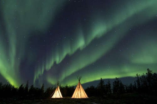 Aurora Teepees Photo by Ron Ross — National Geographic Your Shot