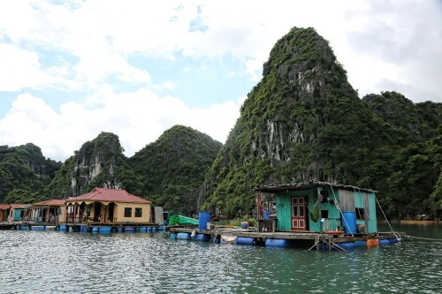 Boat People Homes on Ha Long Bay Photo by Chuck Kuhn — National Geographic Your Shot