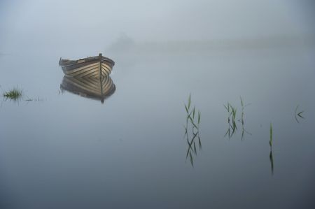Lonely boat at dawn Photo by Alessandro Uttaro — National Geographic Your Shot