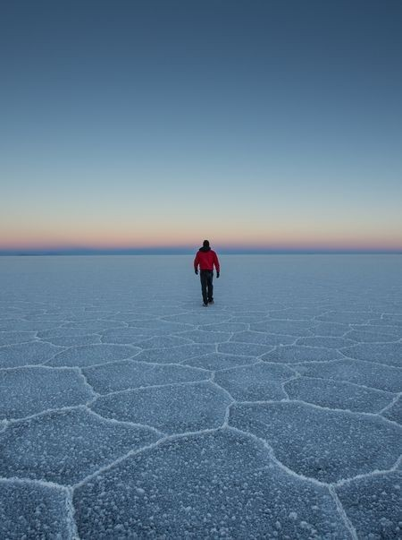 The man crossing the Salar de Uyuni Photo by Rómulo Rejón — National Geographic Your Shot