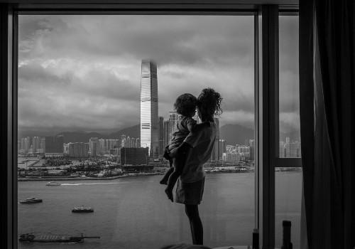 Sofía & Nina staring at Kowloon #2 Photo by Rómulo Rejón — National Geographic Your Shot