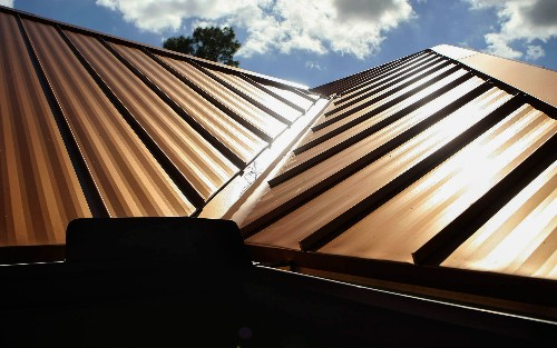 Glass Paint: Secret to Keeping Metal Roofs Cool on Sunny Days