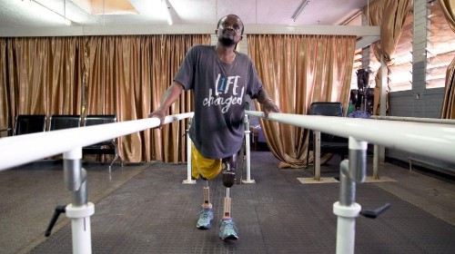 This carpenter builds crutches for kids. Now it's his turn to walk.