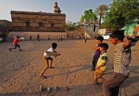 Children playing cricket Photo by Robi (Anirudha) Chakraborty — National Geographic Your Shot