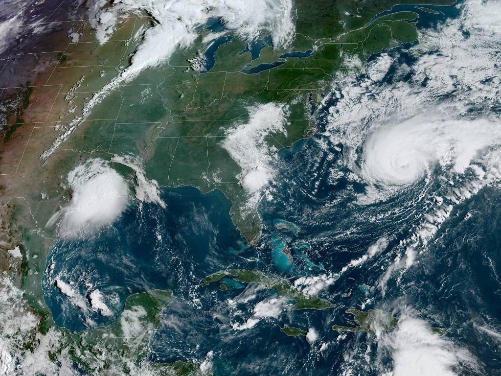 Storm Updates: Imelda Drenches Texas As Humberto Menaces Bermuda