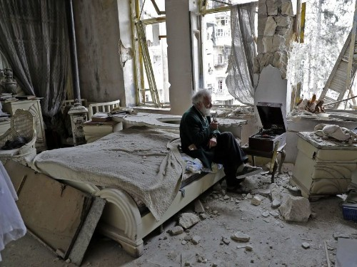 Living Among the Ruins In Aleppo, A Man Keeps Playing His Songs