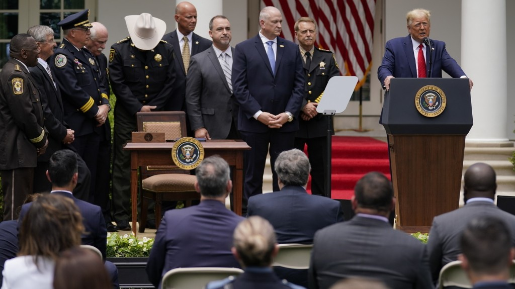 Trump, Hailing Law Enforcement, Signs Executive Order Calling For Police Reform