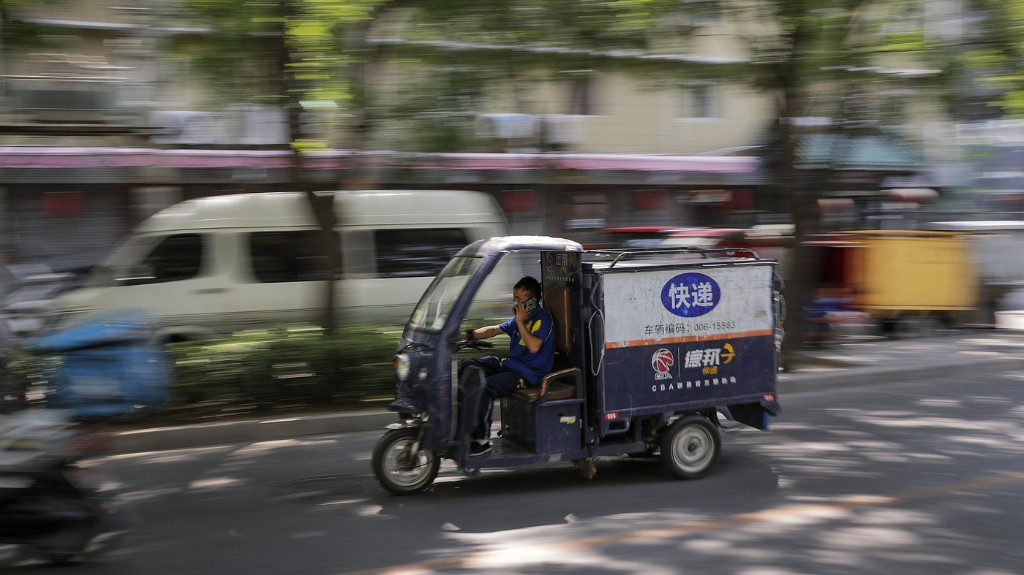 For China's Overburdened Delivery Workers, The Customer — And App — Is Always Right