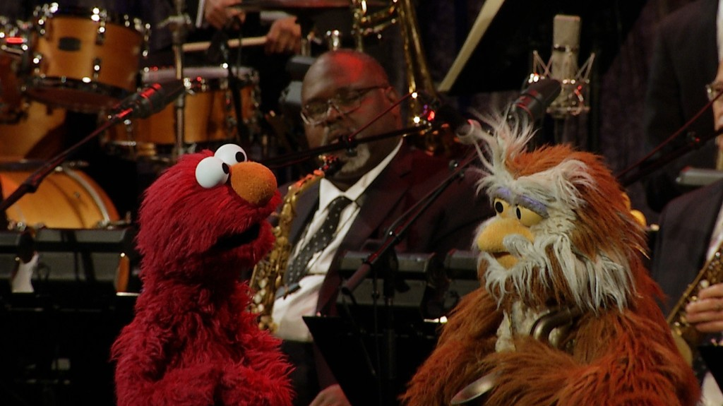 Elmo Sings! Watch Him Perform 'It Feels Good (When You Sing a Song)'