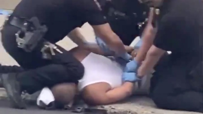 Police Investigate Incident Where Officer Appeared To Use Knee To Restrain Suspect