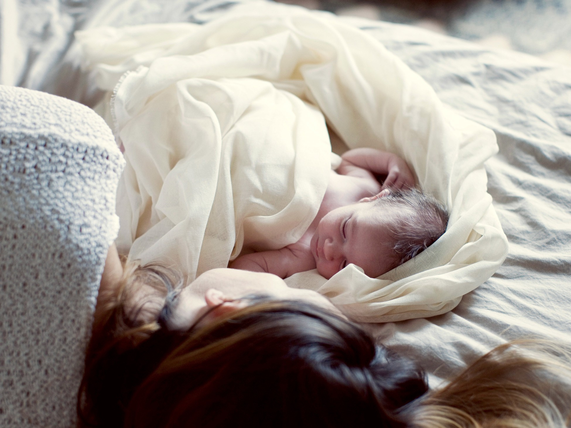 New Guidelines Acknowledge The Reality: Babies Do Sleep In Mom's Bed