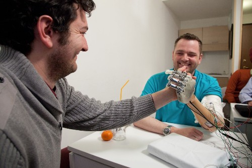 A Mind-Controlled Robotic Hand With A Sense Of Touch