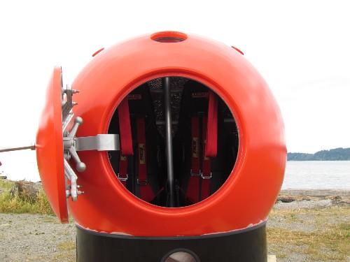Guy Plans To Live Inside Giant Orange Ball On Top Of Melting Iceberg