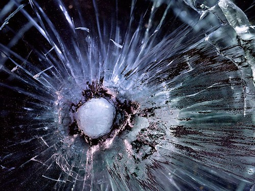 Bullet Holes In Plexiglas Look Like Galaxies