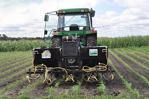 Abrasive Organic Herbicide Method Blasts Weeds To Death